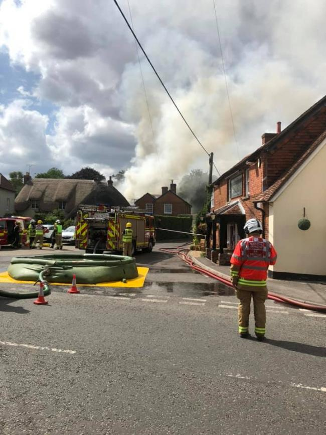 Roads through Sutton Scotney have been closed as crews tackle the blaze (Credit: Peter Burton)