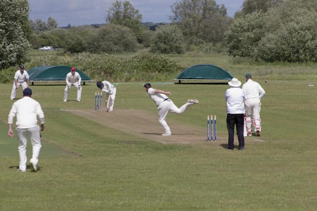 Oliver Emslie takes a wicket