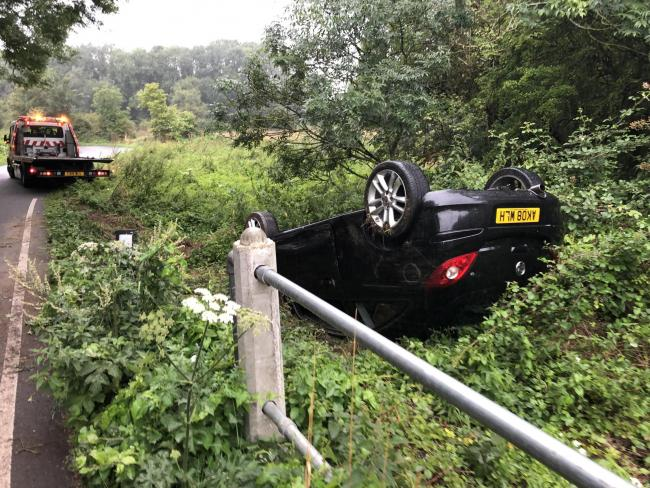 Car flips and crashes into bush