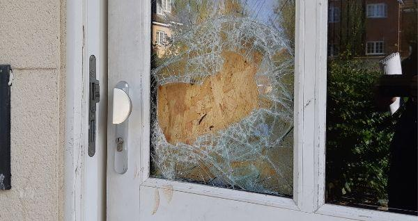A window in the front door to the flat was broken during the incident