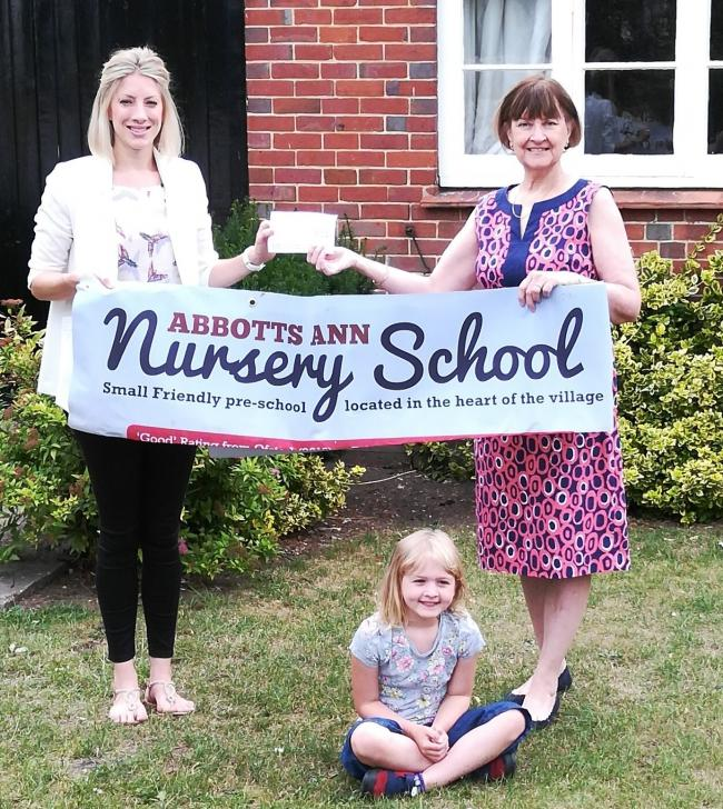 : Nursery treasurer Anna Cooper with Councillor Maureen Flood presenting the cheque