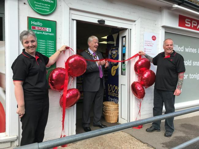 Leslie and Tim celebrate the opening of the Spar, with former mayor Ian Carr, centre