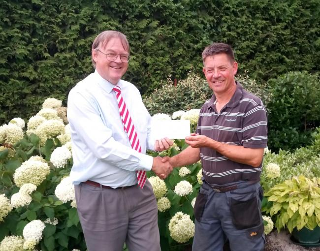 Councillor Drew presenting the cheque to Mark
