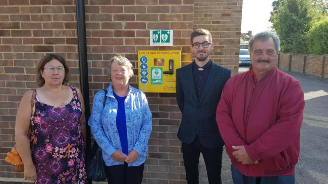 From left, Rachel Brooks, Councillor Watts, Rev Andy Fitchet and town councillor Michael James