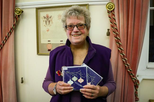 Barbara Long with her packs of Christmas cards, to be sold in aid of Brendoncare