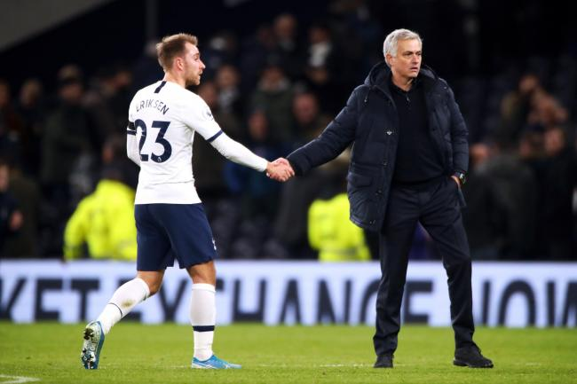 Tottenham manager Jose Mourinho shakes hands with Christian Eriksen