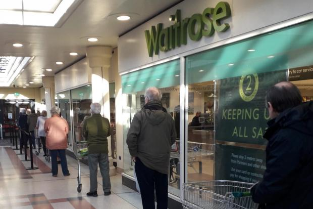 Customers queuing outside Waitrose in the Chantry Centre