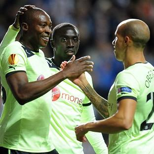 Newcastle's Shola Ameobi, left, celebrates scoring against Bordeaux in their Europa League Group D match