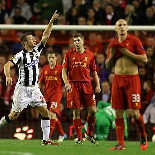 Udinese's Giovanni Pasquale, left, celebrates scoring his side's third goal as Liverpool's players stand dejected