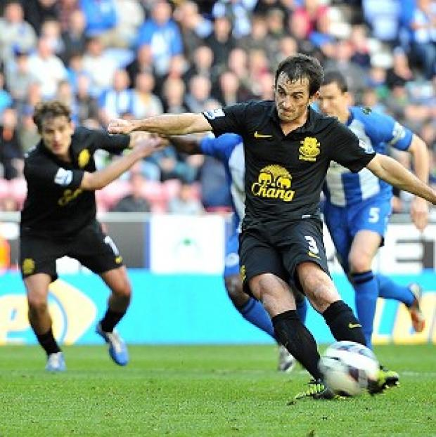 Leighton Baines rescued a point as Everton denied Wigan victory