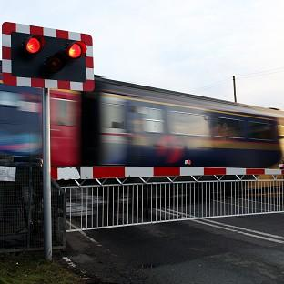 A passenger train has hit a car at an unmanned level crossing near Stranraer
