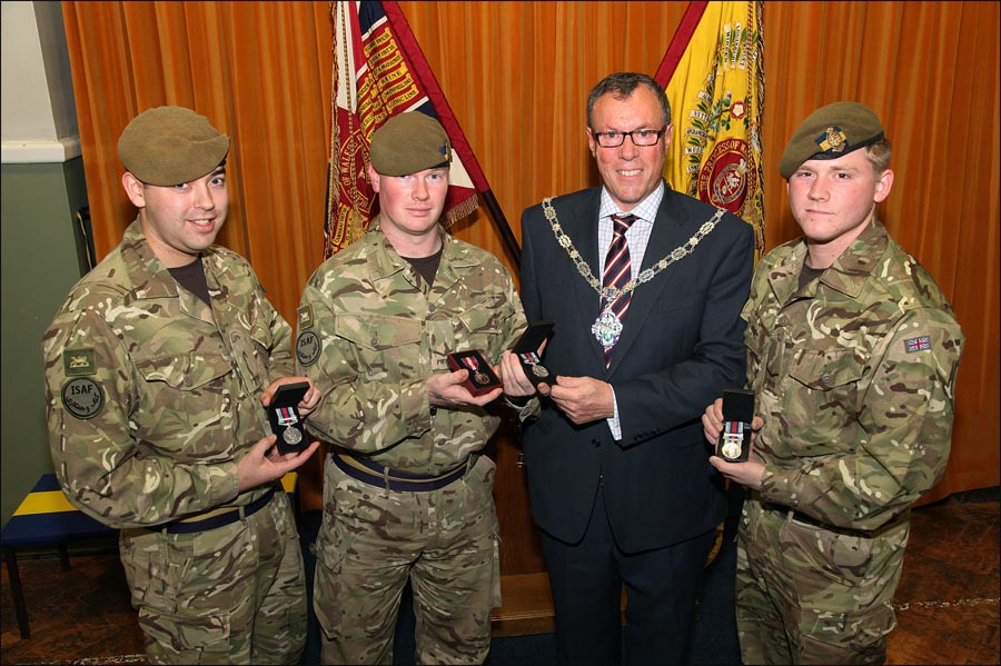 left to right Private Ben Fleming and Lance Corporal Stuart Reid from Reading, the Mayor of Farnham Councillor Stephen Hill and Private Harry Philby from Andover.