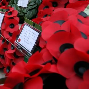 Kent Police have arrested a man for posting a picture of a burning poppy on a social networking website