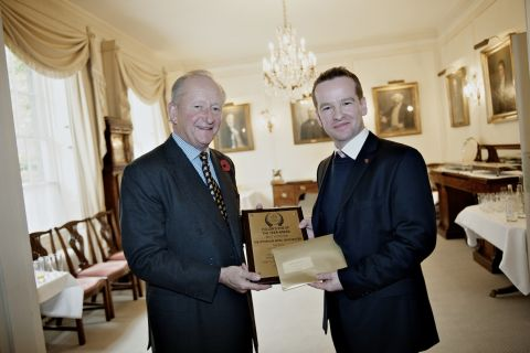 The Wykeham Arms manager Jon Howard (right) receives the award from Fuller's chairman Michael Turner
