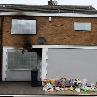 Floral tributes were left outside the home in Harlow, Essex, where Saba
