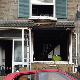 A house has been cordoned off amid an investigation into the cause of a fire