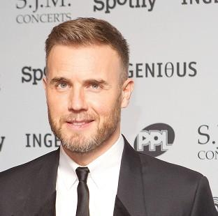 Andover Advertiser: Gary Barlow is to receive his OBE at Buckingham Palace