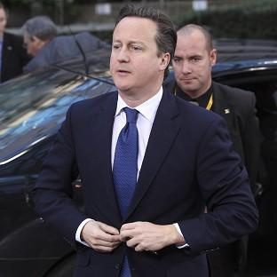 Andover Advertiser: David Cameron arrives for the EU summit in Brussels (AP)