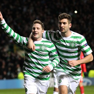 Celtic's Kris Commons, left, celebrates scoring the winning goal from the penalty spot