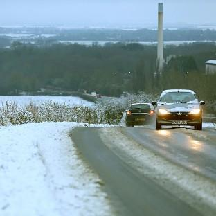 Motorists make their way through the snow at Barrington in Cambridgeshire