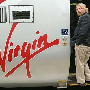Virgin will carry on running the West Coast Main Line until November 2014