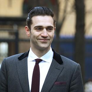 The boyfriend of late singer Amy Winehouse, Reg Traviss, denies two charges of rape