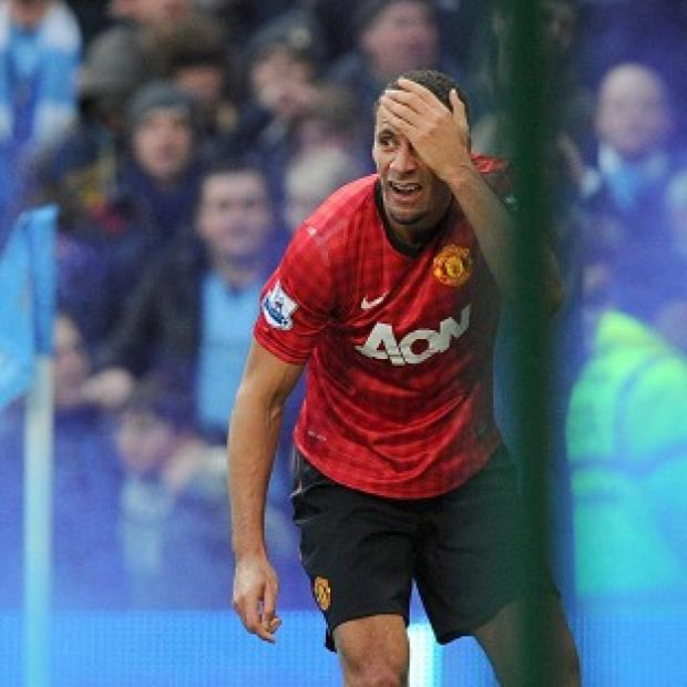 Manchester United defender Rio Ferdinand was left with a cut to his left eyebrow after being hit by a coin while celebrating his team's winning goal