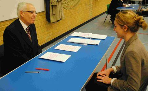 Alresford Rotarian Bob Germon quizzes 15-year-old Perins pupil Megan Fursdon