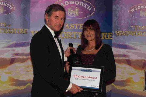 Charles Bartholomew, chairman of Wadworth, with Jayne Gillin of St James' Tavern