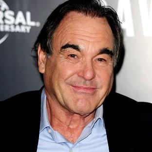 Film-maker Oliver Stone condemned the use of live pigs in MoD training exercises