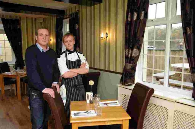 Basingstoke Town FC commercial manager Dean Coombs with The Sun Inn head chef Gordon Scott