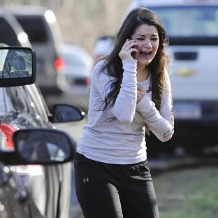 A woman waits to hear about her sister, a teacher, following the shooting at Sandy Hook Elementary School in Newtown, Connecticut (AP)