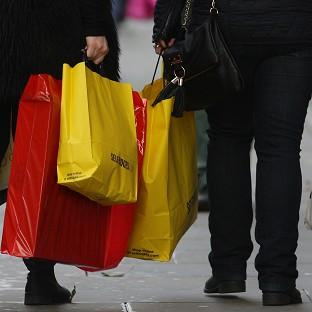 Shoppers with bags during last minute Christmas shopping in Manchester