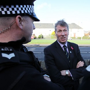 Justice Secretary Kenny MacAskill talking with officers from Lothian and Borders Police