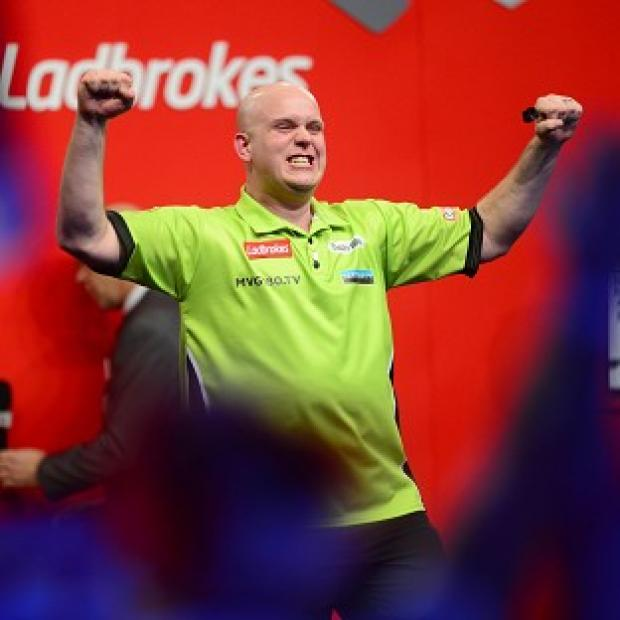 Michael van Gerwen celebrates after securing his place in the final