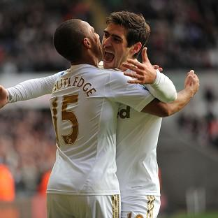 Andover Advertiser: Danny Graham, right, snatched a point for Swansea against Villa