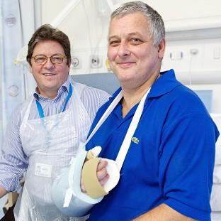 Andover Advertiser: Hand transplant patient Mark Cahill (right) with Professor Simon Kay at Leeds General Infirmary