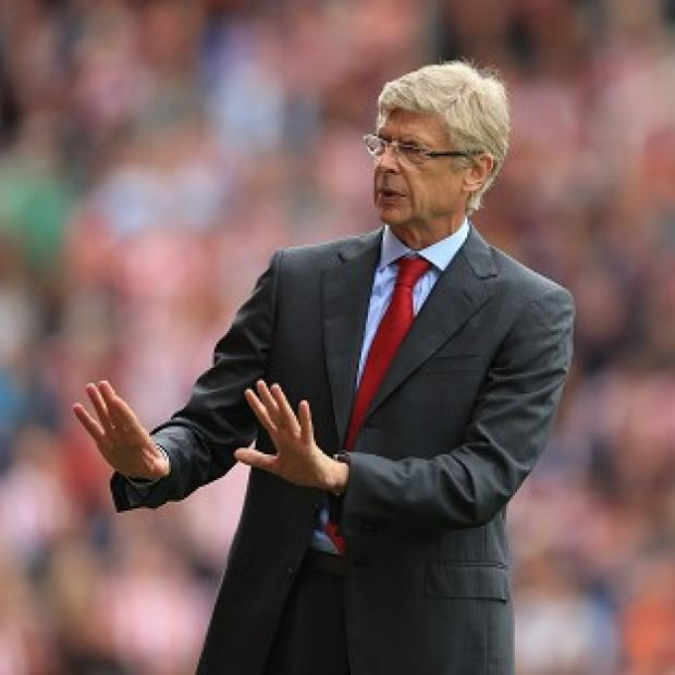 Arsene Wenger insists talk of reaching the FA Cup final would be premature for Arsenal