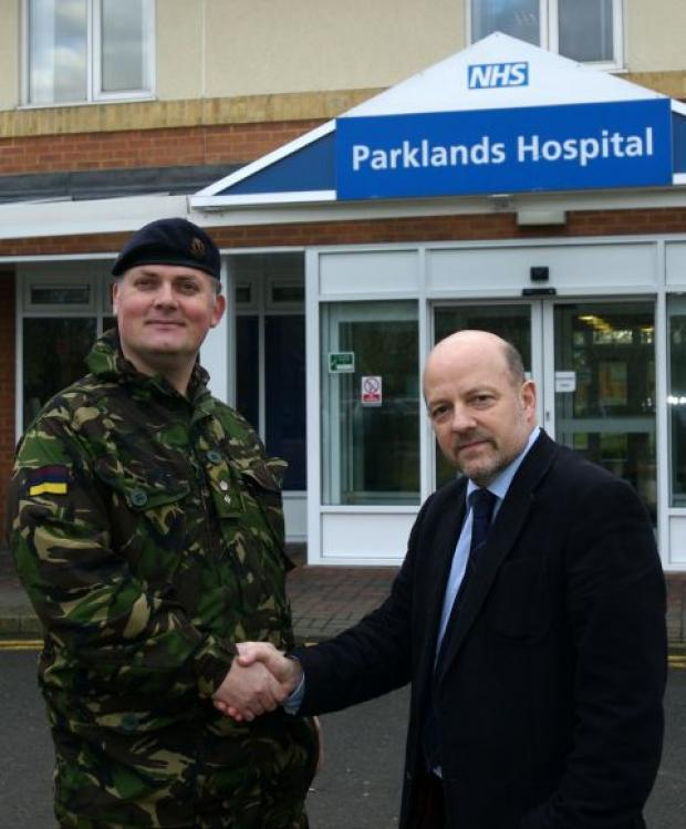Lieutenant Colonel Pete McAllister, head of Army Psychiatry, with Pual Warren, when the contract was first awarded to Parklands Hospital in 2009