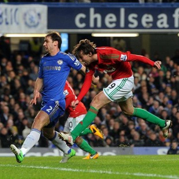Michu, right, scored Swansea's opening goal of the game against Chelsea