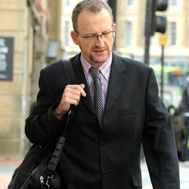 Professor Stephen Graham allegedly damaged luxury cars by scratching polite graffiti on them