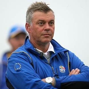 Darren Clarke has hinted he would rather carrying on playing than captain Europe