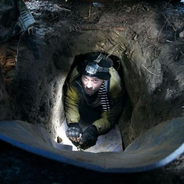A road protester known as Simon Sittingbull emerges from a tunnel he has dug at the Combe Haven Defenders camp near Crowhurst, East Sussex