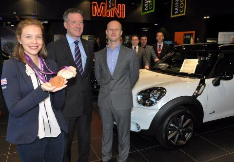 Bethany Woodward with general sales manager Darren Chatterley and MINI brand manager Stuart Remnant