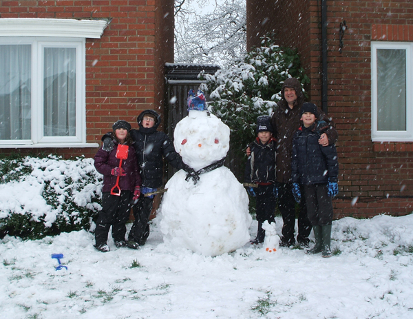 Andover Advertiser: Dave Brine with his family snowman.