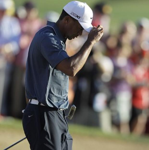 Tiger Woods was penalised over an embedded-ball incident on the fifth hole (AP)