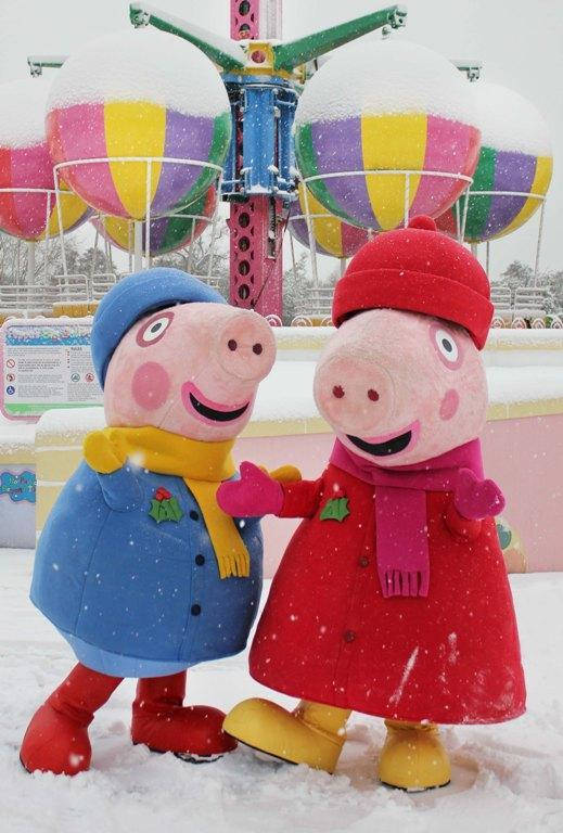 Andover Advertiser: Peppa Pig and George enjoy the snow at Paultons Park