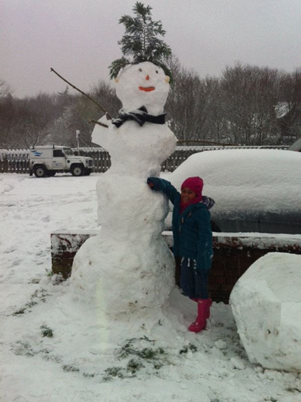 Andover Advertiser: Amelia Davies with a giant snowman.