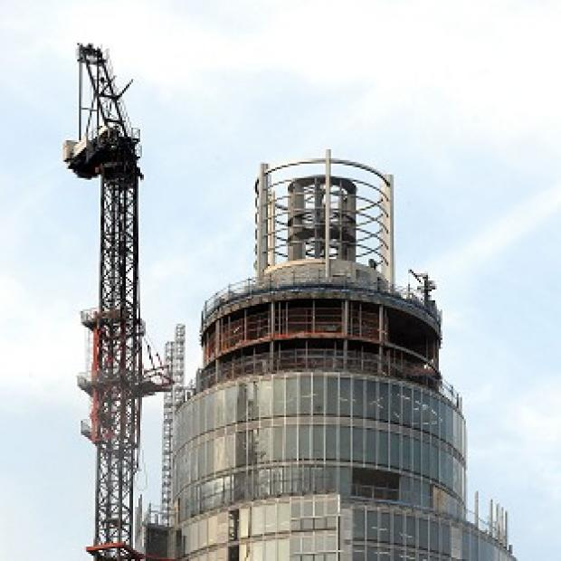 The crane at the top of St George's Wharf tower where a helicopter crashed, killing two people, in south London