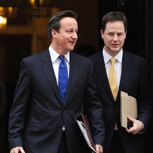 Andover Advertiser: Nick Clegg, right, said David Cameron's promise to renegotiate Britain's place in Europe was 'vague'